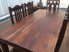Beautifully carved Sheesham Indian dining table with 6 chairs. 2 chairs wicker seats, 4 solid wood
