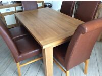 Solid oak table and six faux leather upholstered high back chairs