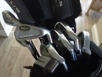 Full set of ultima Golf clubs bag and trolly .in good condition.