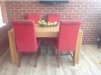Large table and 4 red chairs