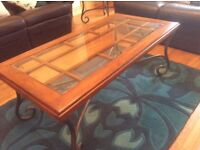 Coffee table with bevelled glass top and wrought iron frame