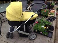 Mamas & Papas complete travel system with raincover.