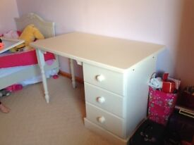 Child's bed in solid pine in antique white for sale.