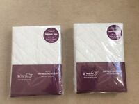 Two single bed mattress protectors, brand new.