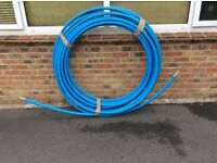 20 plus meters of 32mm blue water pipe.new unused.spare from a new connection.