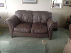 Leather suite includes 2 two seater sofas, 1 armchair and 1 foot stool. .