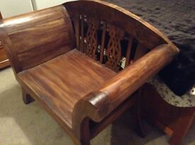 Large solid wood chair.