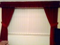2 Pairs of lined velvet russet curtains with pelmets, tie backs and 5 cushions
