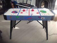 Children's air hockey table