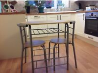 Small bistro style table and two chairs
