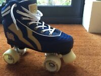 Unworn pair of girls roller skates, size 5. Navy. Rio Roller - high roller.