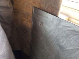 Large unframed wall mirror