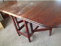 Oval drop leaf dining table, some marking