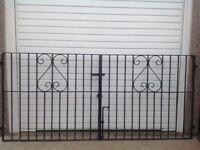 Two metal driveway gates
