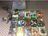 X box crystal console with 17 games, controller and remote control.