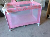 Travel cot ,pink with hearts around the top. £15 ono