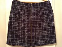Black & White skirt, size 16, zips up front and fully lined. Check out my other items for sale!