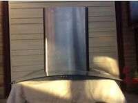 For sale 60cm wide curved glass chimney extractor.good condition £15.