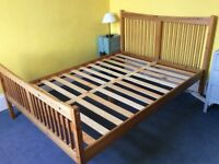 Wooden double bed, VGC with a couple of small scratches on leg. Mattress not included.