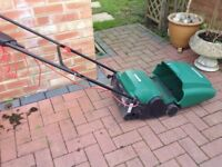Electric cylinder lawnmower with grass box