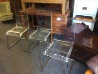 3 clear acrylic chairs