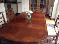 Lovely walnut table and six chairs two of which are carvers