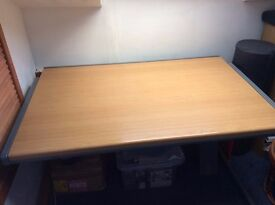 Desk with wood top and strong metal frame.