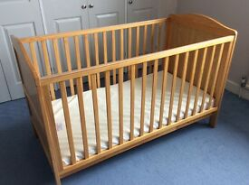 Cotbed in excellent condition. Used occasionally at grandparent's home. Mattress included.