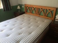 Double bed with integral solid wood headboard