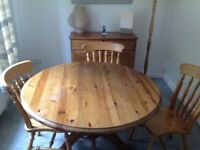 Round table and 4 chairs plus sideboard.