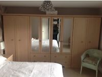 4 matching Wardrobes with 2 bedside cabinets, 2 wardrobes with mirrors.
