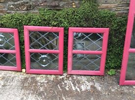 Hard wood double glazed windows with lead and bull's eyes