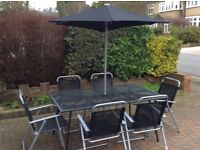 Garden table and chairs, like new, could deliver