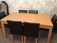 Beech Coloured dining/ kitchen table and 6 darkest brown chairs.