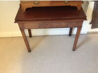 Beautiful old wooden table with drawer.
