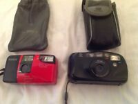 2 Instamatic cameras Konica and Minolta with cases