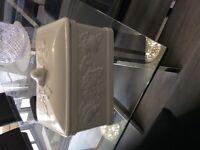 White ceramic bread bin