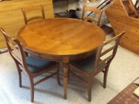 Solid pine round dining table and four chairs