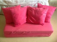 Pink sofa bed and cushions, used but good condition, ideal for girl's bedroom