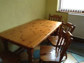 Solid pine kitchen table and four chairs