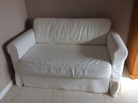 Ikea Haguland sofa bed,in good condition with washable cream cover .