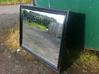 Large wooden framed over mantle mirror with beveled edge glass