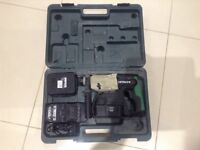 Hitachi 24V hammer drill with two batteries and carry case.
