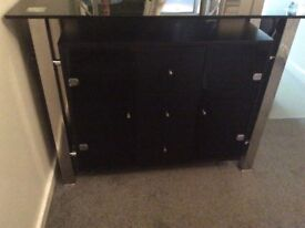 Dark glass top with two cupboards /3draws