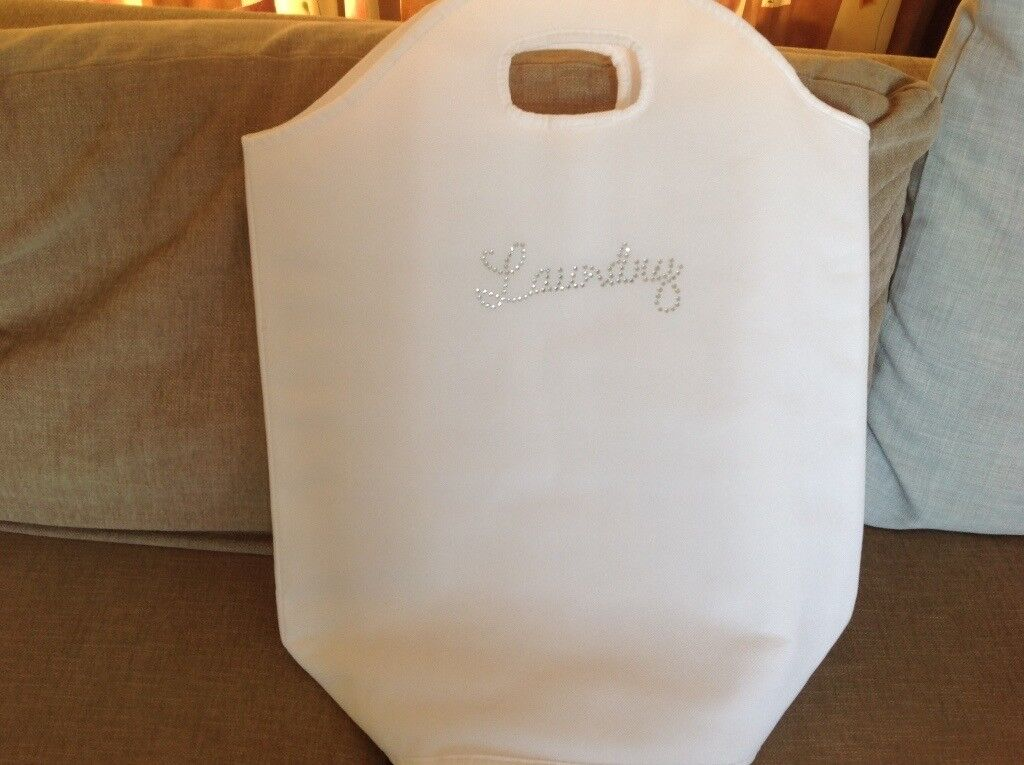 Small white laundry bag. As new.