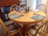 Extendable dining room table and four chairs, seats fourRound table extends to oval and sits 6 to 8.