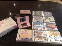 Nintendo DS, charger and nine games