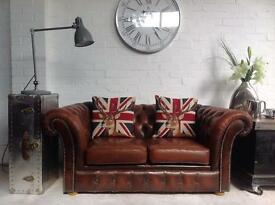 Antique brown 2 seater Chesterfield sofa. Matching pair available.