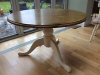 Solid 'antique' pine circular table and 4 chairs