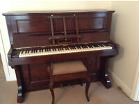 Upright piano in excellent condition. Full working order. Beautiful mahogany case